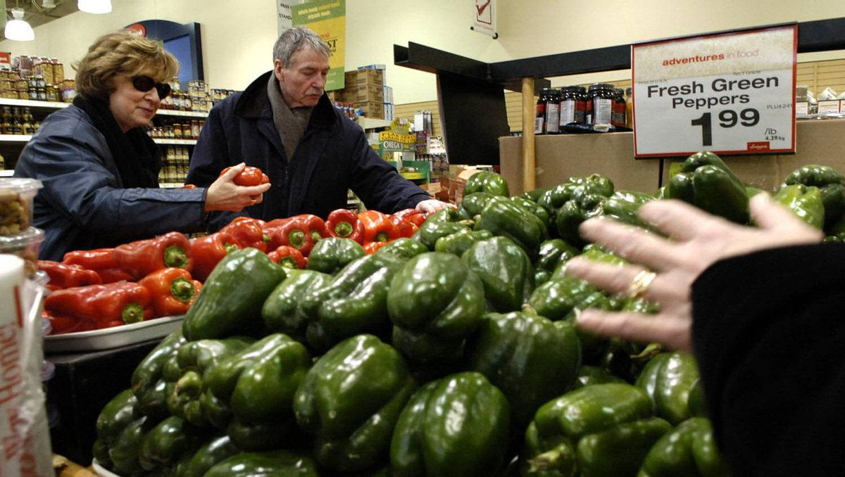 Longo's grocery store shoppers check over the selection of peppers on sale in the produce department at Longo's grocery store on York Mills Road in North Toronto.
