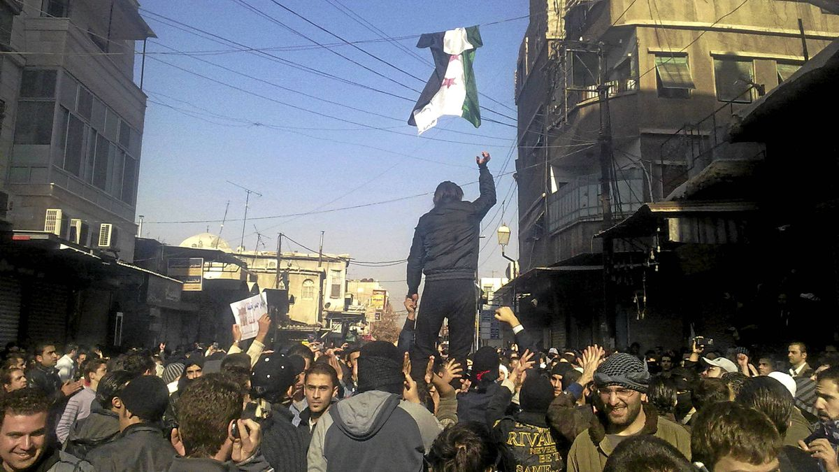 Demonstrators protest against Syria's President Bashar al-Assad in al-Midan district in Damascus Dec. 19, 2011.