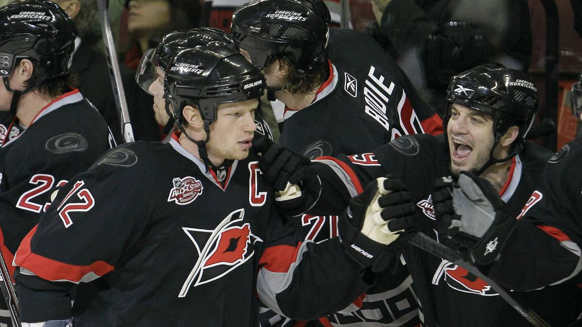 Carolina Hurricanes' Eric Staal (12) is congratulated by Chad LaRose following Staal's goal against the Anaheim Ducks during the first period of an NHL hockey game, Saturday, Dec. 18, 2010, in Raleigh, N.C. The 'Canes won 4-2. (AP Photo/Gerry Broome)