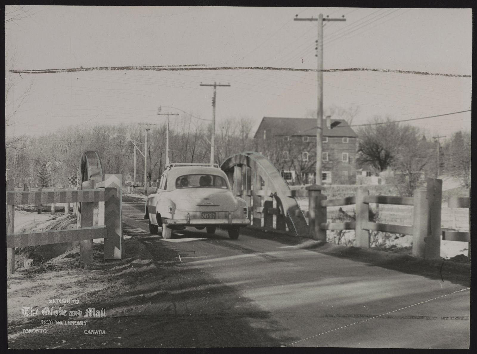 Bayview Ave, (Toronto ) Contrariwise there is no speed limit sign at bridge on Bayview Ave, just south of Steele's Ave. though it is strictly a one lane bridge. Further south Bayview has been Surfaced and could easily be turned into a four-lane thoroughfare. 1955. Toronto; Bayview Avenue, one-lane bridge south of Steeles. Accession#: 55360-4