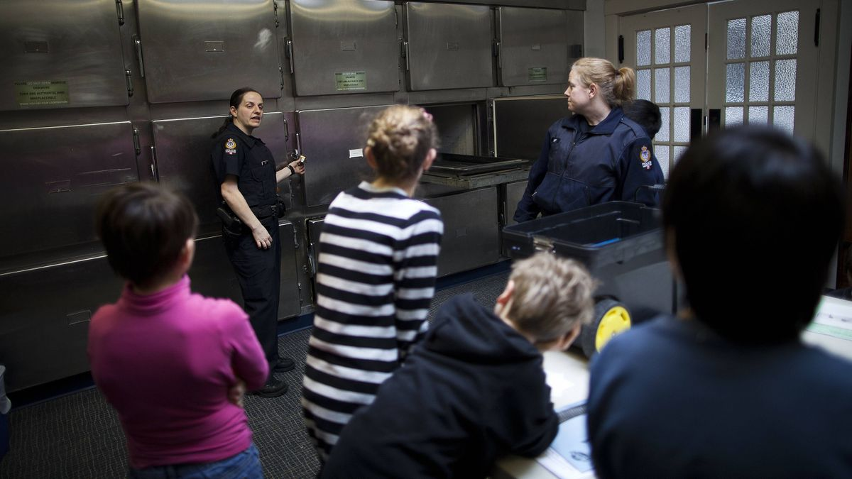 Training officer Tanya McLachlan, left, and Constable Cathy Hill show students how to use various equipment in the morgue.