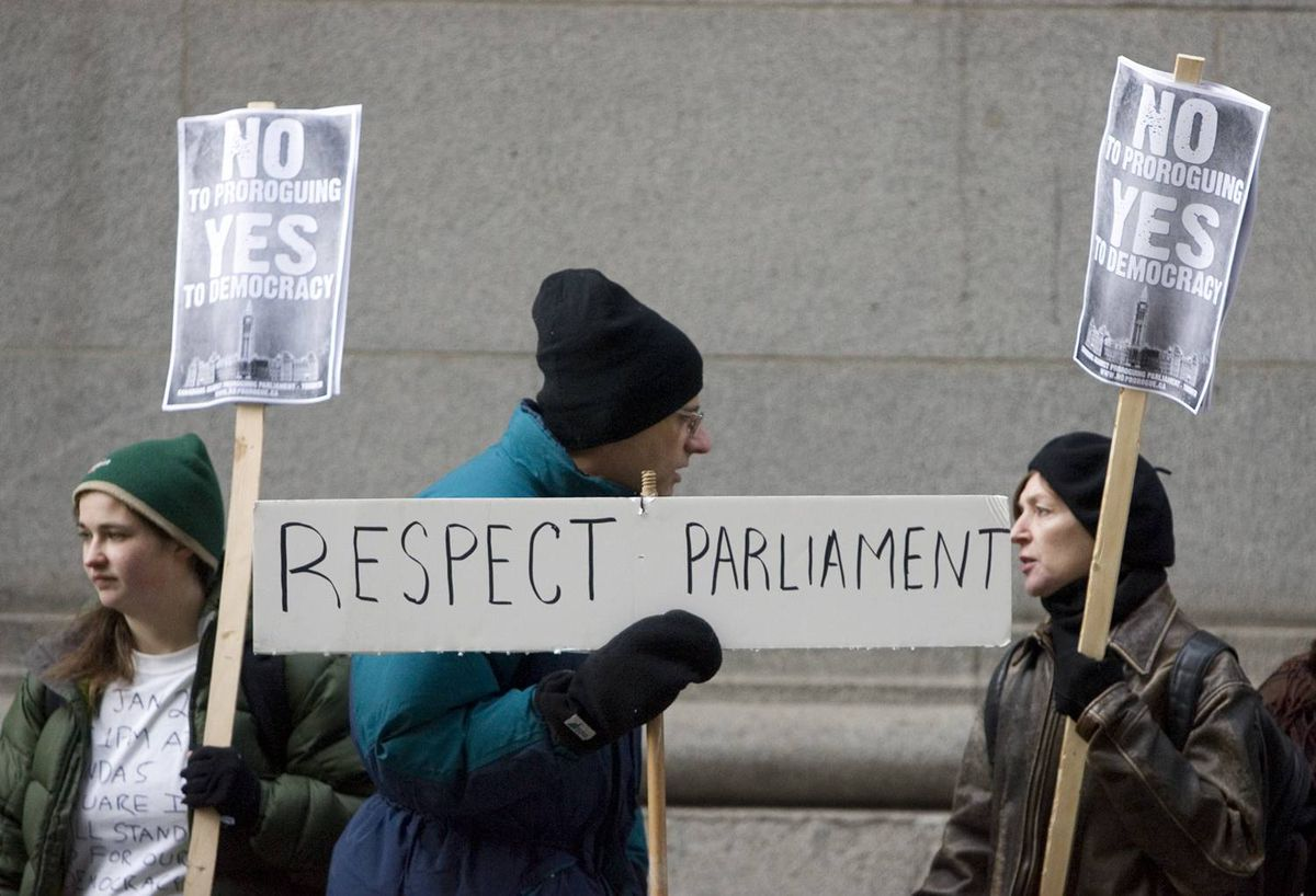 Anti-prorogation protesters gather outside the C.D. Howe Institute in Toronto, where Prime Minister Harper attended a roundtable meeting on Wednesday, Jan. 20, 2010.