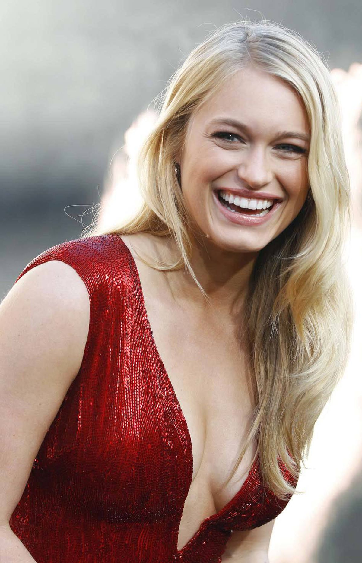 """Cast member Leven Rambin teeters forward at the premiere of """"The Hunger Games"""" in Los Angeles on Monday."""