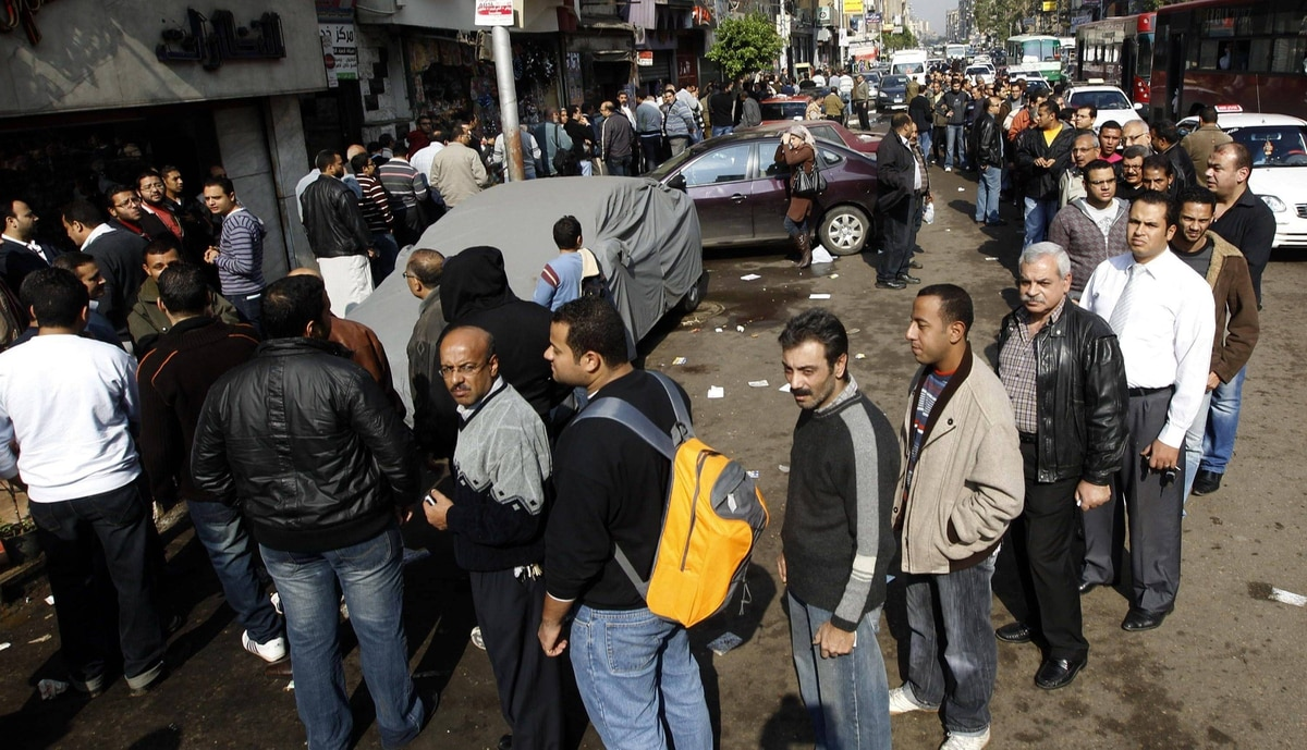 People queue outside a polling station to vote in the parliamentary election in Shubra neighbourhood, Cairo November 28, 2011.