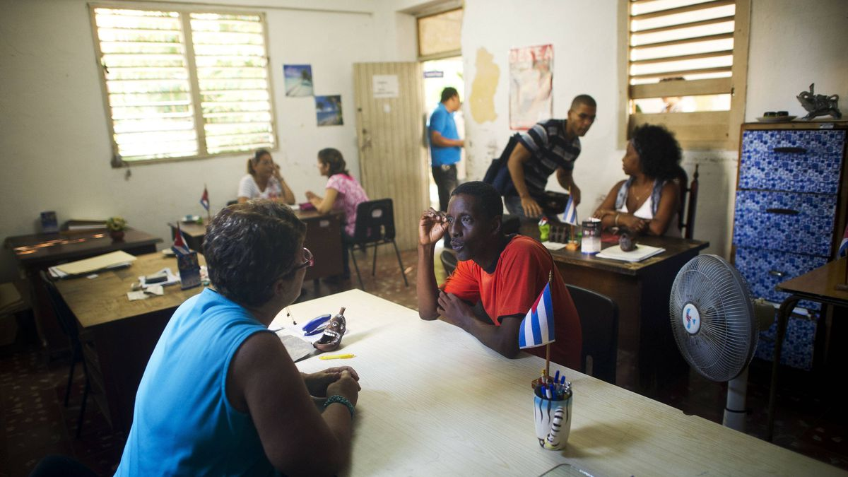 Bureacrats process applications for small business licences at the Employment and Social Services Office in Plaza Revolucion in Havana, Cuba Sept. 27, 2011.