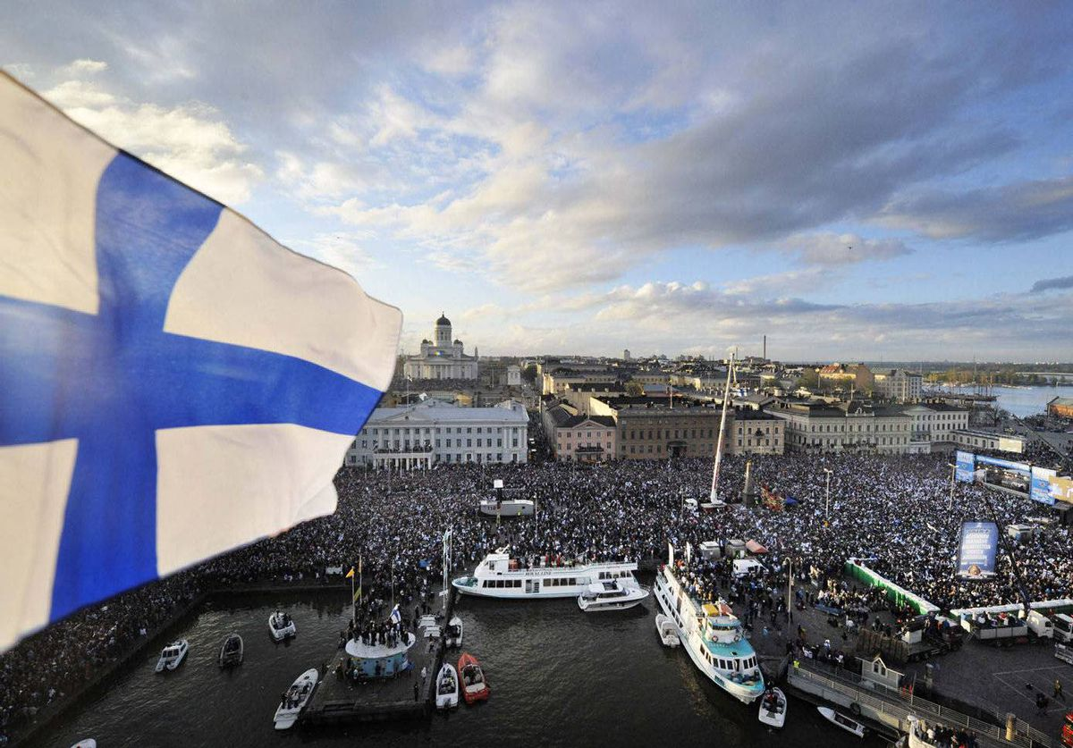 Tens of thousands of Finns gathered in the capital Helsinki on Monday to celebrate their first ice hockey world title in 16 years.