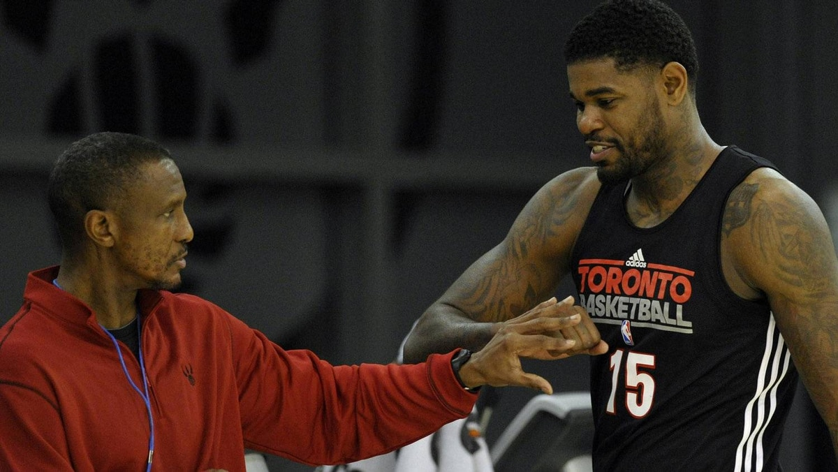 Toronto Raptors Amir Johnson greets head coach Dwane Casey (L) during the team's first practice of their NBA basketball season in Toronto December 9, 2011. REUTERS/Mike Cassese