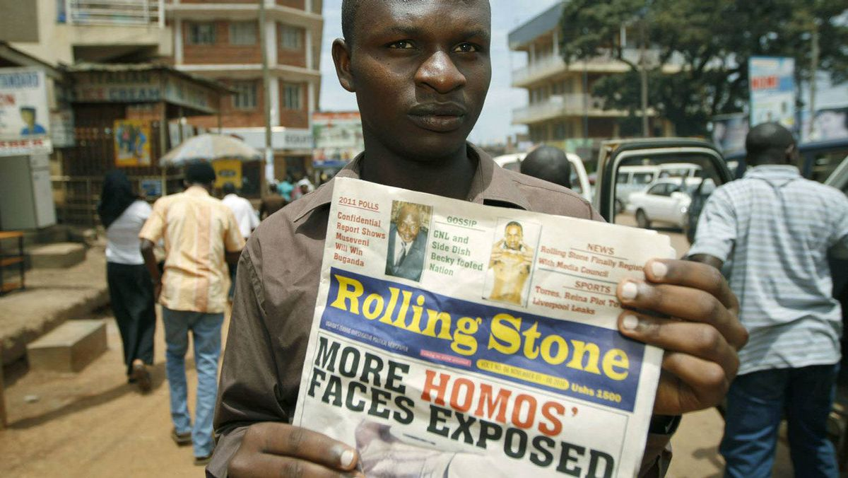 A November 2010 file photo shows the editor of Uganda?s Rolling Stone newspaper, Giles Muhame, holding an issue of the publication in a street of Kampala.