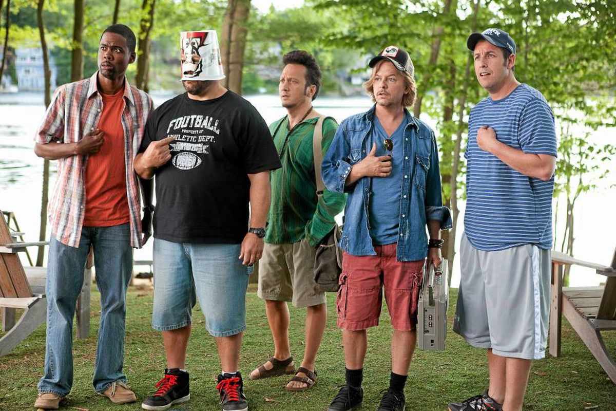 From left, Kurt (Chris Rock), Eric (Kevin James) with a KFC bucket on his head, Rob (Rob Schneider), Marcus (David Spade), Lenny (Adam Sandler) in Columbia Pictures' Grown Ups
