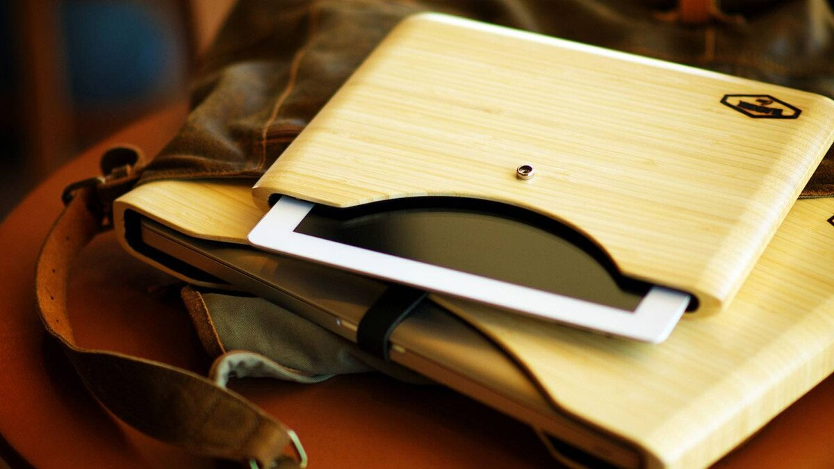 Blackbox wooden cases Crafted out of red oak and bamboo, and lined with wool felt, these cases, for iPad 2 and MacBook Pro laptops, beg to be handled. Wood is lightweight and strong, both functional and protective. Custom engraving of text and graphics is also available. (US$99–$164; blackboxcase.com)