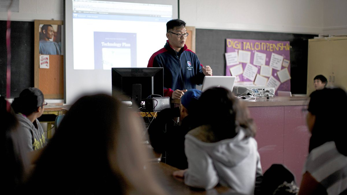 Zhi Su, John Oliver Secondary School's Technology Director and teacher, teaches students about using the google calendar at John Oliver Secondary School in Vancouver, British Columbia, Tuesday, Feb. 14, 2012.