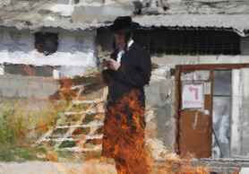 An ultra-Orthodox Jew is seen through a heat mirage as he prays beside a fire burning leaven in the Mea Shearim neighbourhood of Jerusalem, ahead of the Jewish holiday of Passover.