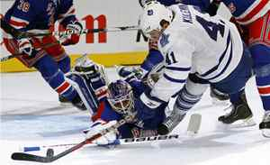 New York Rangers' goalie Henrik Lundqvist (bottom) makes a sprawling save on a shot by Toronto Maple Leafs' Nikolai Kulemin (41) during the second period of their NHL hockey game at Madison Square Garden in New York, October 27, 2011.