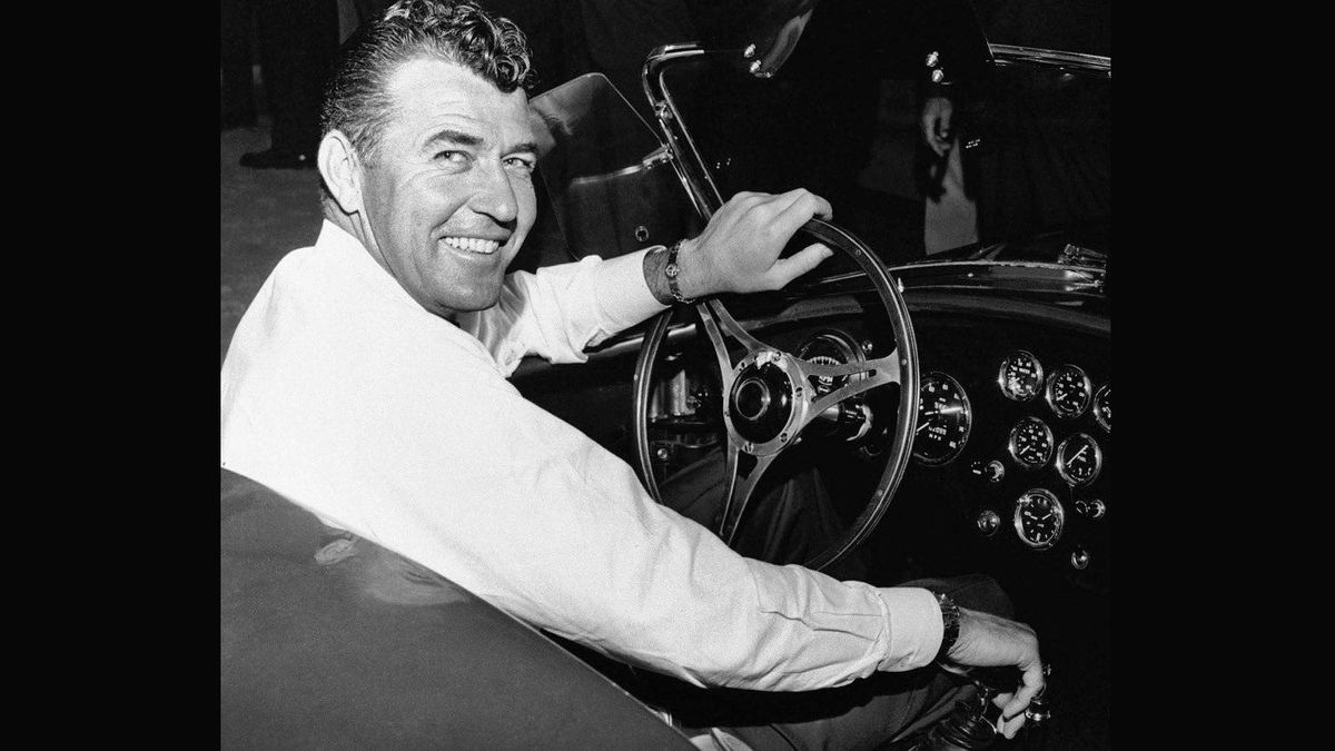 Carroll Shelby at the wheel of a new Cobra production car in 1963.