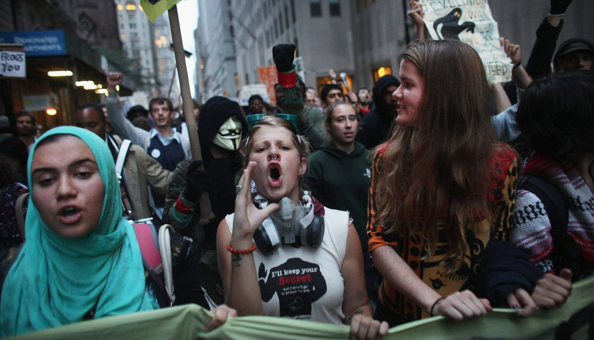 Demonstrators associated with the 'Occupy Wall Street' movement face off with police in the streets of the financial district after the deadline for their removal from Zuccotti park was postponed.