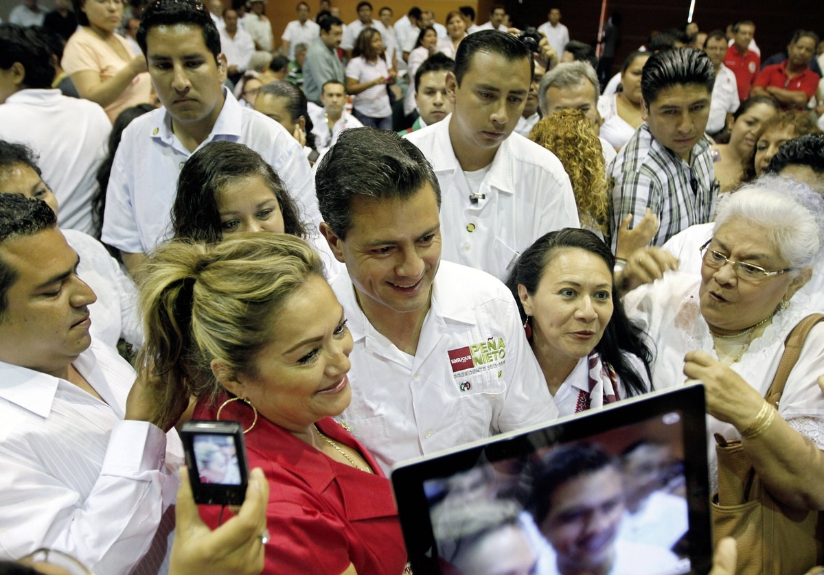 Enrique Pena Nieto, presidential candidate for Mexico's Institutional Revolutionary Party (PRI) is mobbed by supporters while arriving at a campaign rally with oil workers in Ciudad del Carmen, Campeche, Mexico on May 16, 2012.