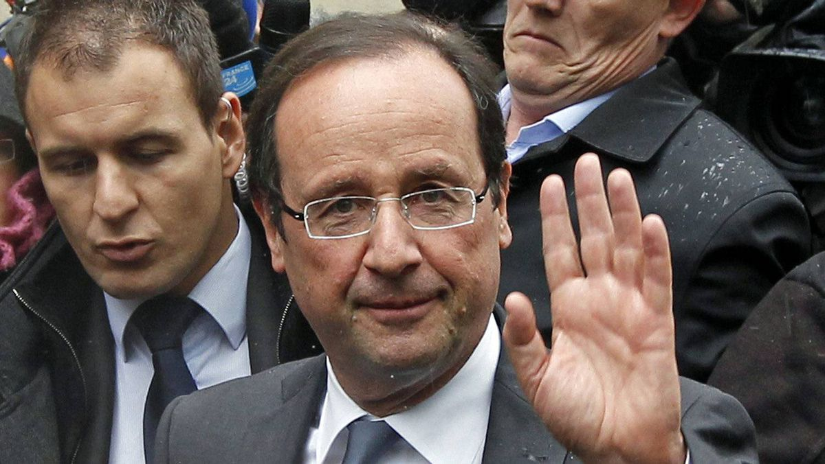 Francois Hollande, Socialist Party candidate for the 2012 French presidential election, leaves his campaign headquarters in Paris on April 23, 2012.