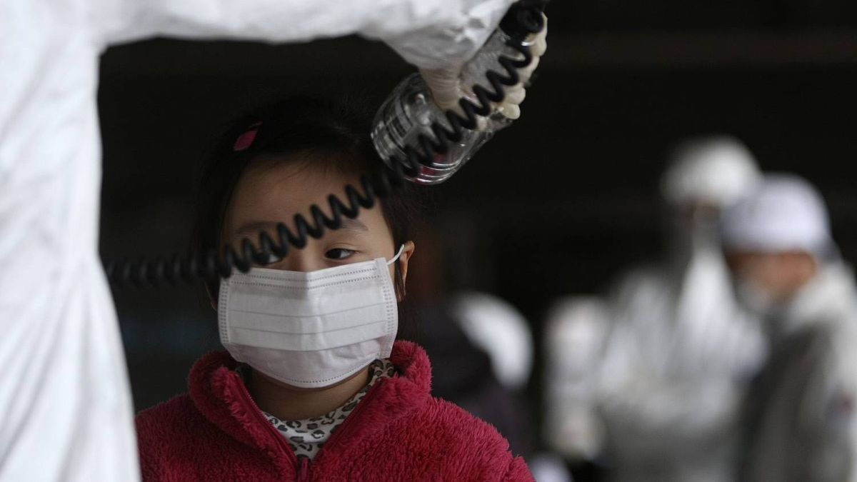 A young girl is screened for radiation at a shelter for those evacuated from areas around the damaged Fukushima nuclear plant, Thursday, March 24, 2011 in Fukushima, Fukushima prefecture, Japan. Radiation has seeped into raw milk, seawater and 11 kinds of vegetables, including broccoli, cauliflower and turnips, grown in areas around the plant.