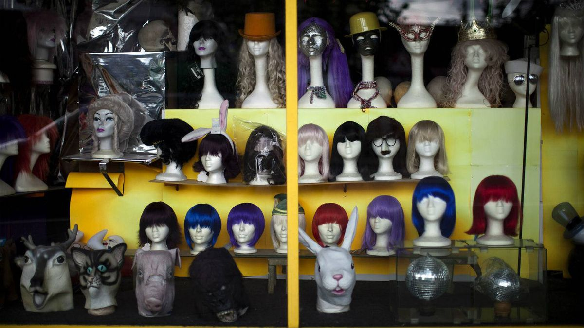 Wigs and mannequins heads seen here in a store front window in the Mount Pleasant neighbourhood of Vancouver, British Columbia, June 30, 2011.