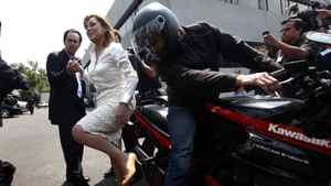 Josefina Vazquez Mota, presidential candidate of the National Action Party (PAN) arrives at the building of Federal Electoral Institute on a motorcycle before registering as a presidential candidate for the upcoming July 1 federal elections in Mexico City March 17, 2012.