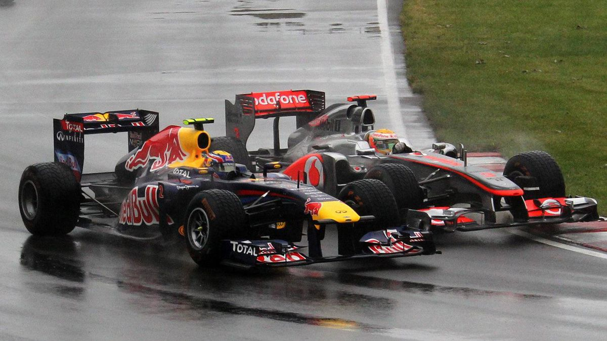 Red Bull's Mark Weber, left, and McLaren's Lewis Hamilton drive into the Senna corner at the Canadian Grand Prix last year.