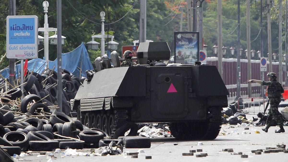"""A Thai armoured vehicle and a soldier approach a barricade during an operation to evict anti-government """"red shirt"""" protesters from their encampment in . Caren Firouz/Reuters"""