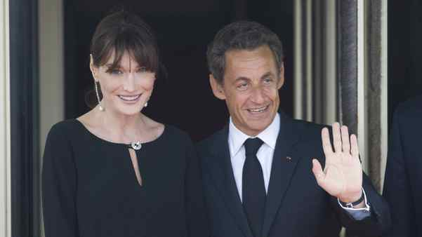 French President Nicolas Sarkozy and his pregnant wife Carla Bruni-Sarkozy await the arrival of G8 leaders and their spouses for an evening dinner function at Le Ciro's Restaurant at the G8 Summit on Thursday in Deauville, France.