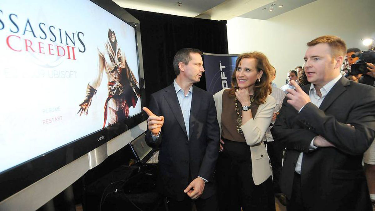 Ontario Premier Dalton McGuinty, left, Sandra Pupatello, Minister of Economic Development and Trade, and Yannis Mallat, CEO Ubisoft, appear at a Toronto press conference on Monday, July 6, 2009, announcing a new video game studio in Toronto, to create 800 jobs in Ontario.