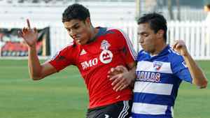 FC Dallas' Bruno Guarda (8) fights for the ball withToronto FC's Luis Silva (11) during the first half of a soccer match in the Walt Disney World Pro Soccer Classic, Thursday, March 1, 2012, in Lake Buena Vista, Fla.