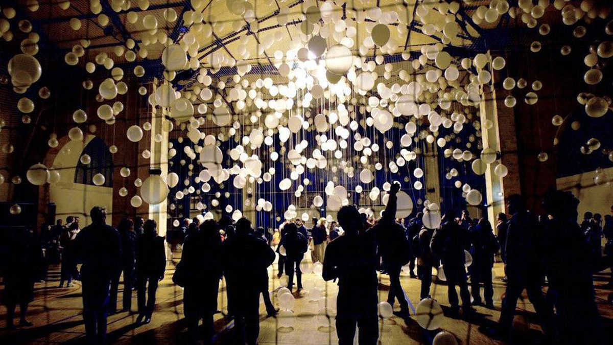 People gather in front of an installation by US artist William Forsythe for the second Nuit Blanche de Paris