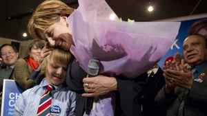 B.C. Premier Christy Clark hugs her son Hamish after she won the provincial by-election in Vancouver Point-Grey.