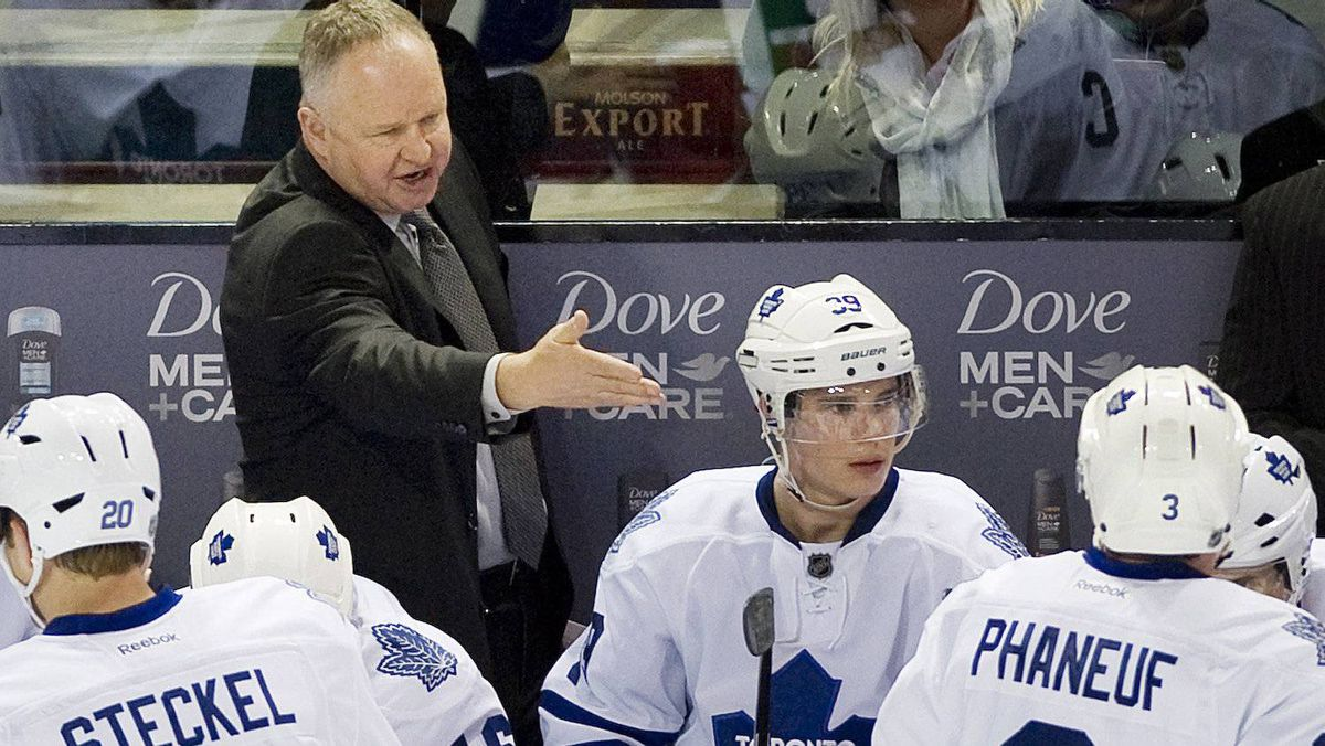 Toronto Maple Leafs head coach Randy Carlyle talks with players during second period NHL hockey game action against the Montreal Canadiens in Montreal, Saturday, March 3, 2012. THE CANADIAN PRESS/Graham Hughes