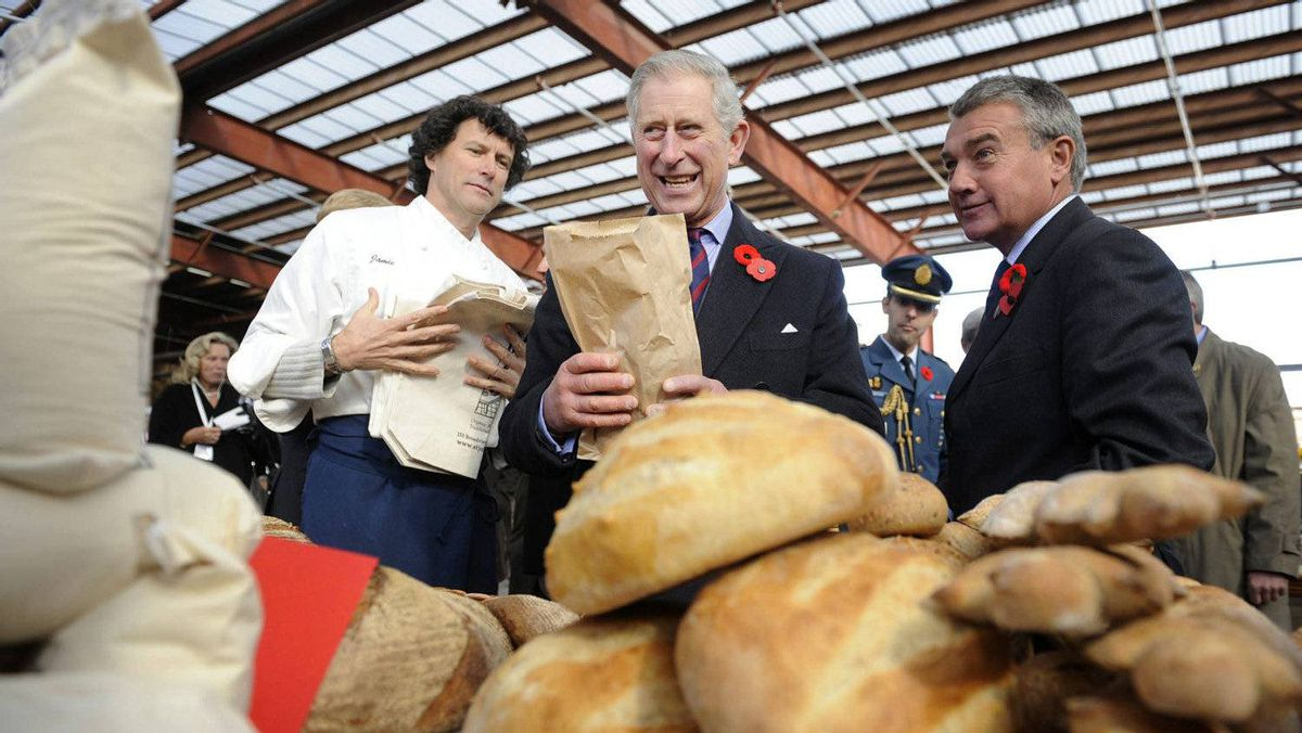 Prince Charles purchases a loaf of bread as he toured a farmer's market at the Brick Works in Toronto, Nov. 6, 2009.
