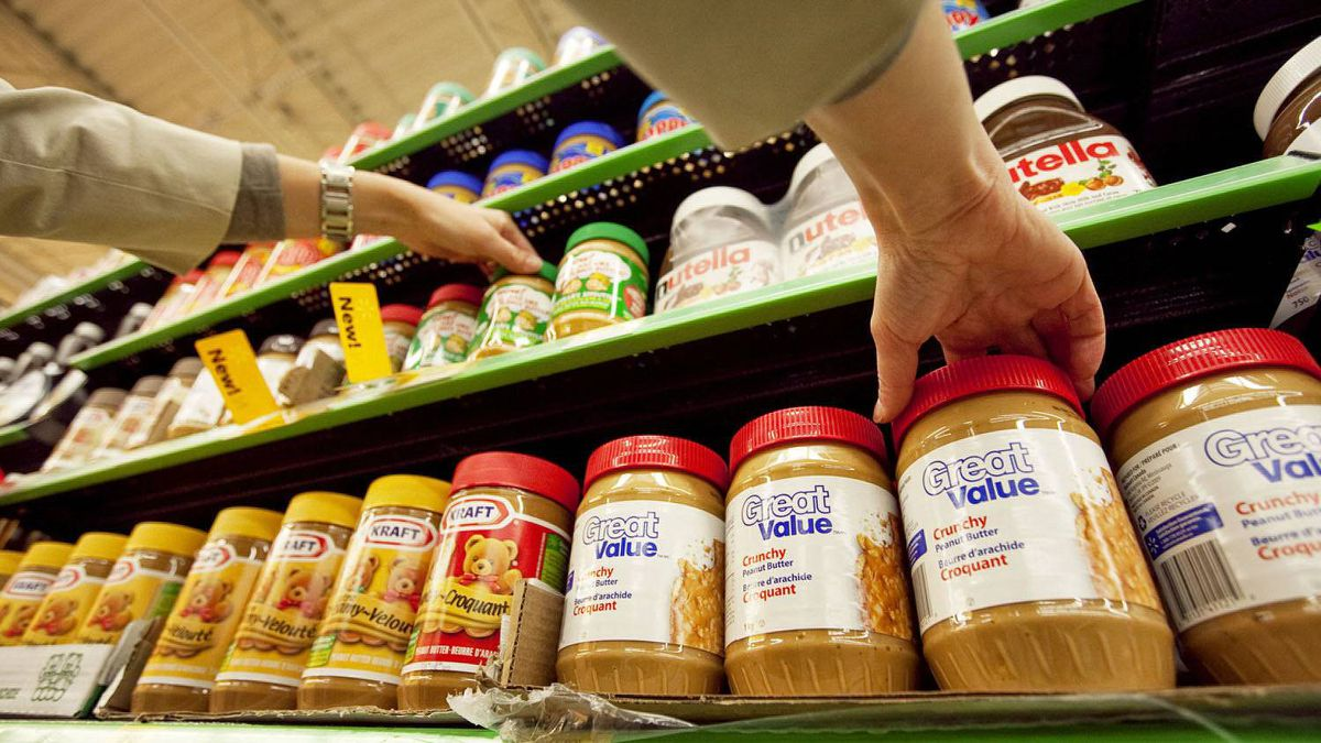Jars of peanut butter are arranged on a shelf at the Heartland Wal-Mart in Mississauga.