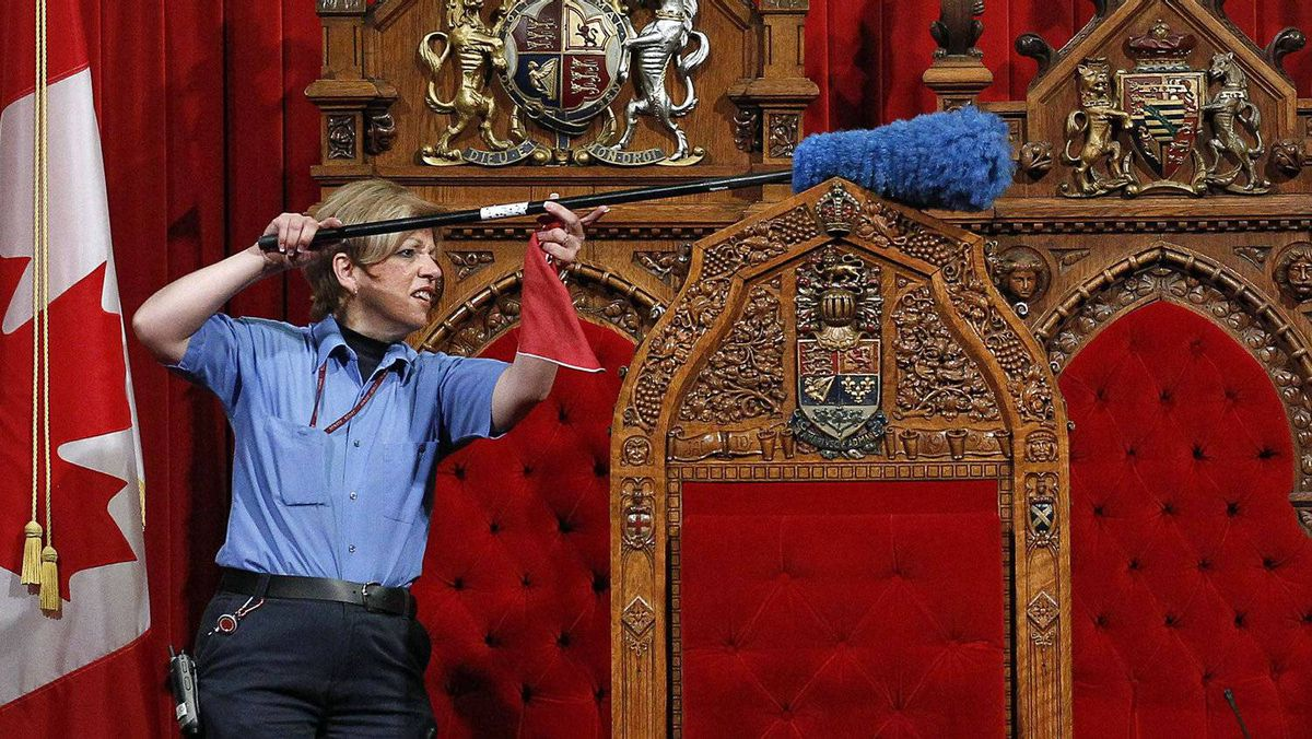 A worker cleans the Senate chamber in Ottawa on June 1, 2011.