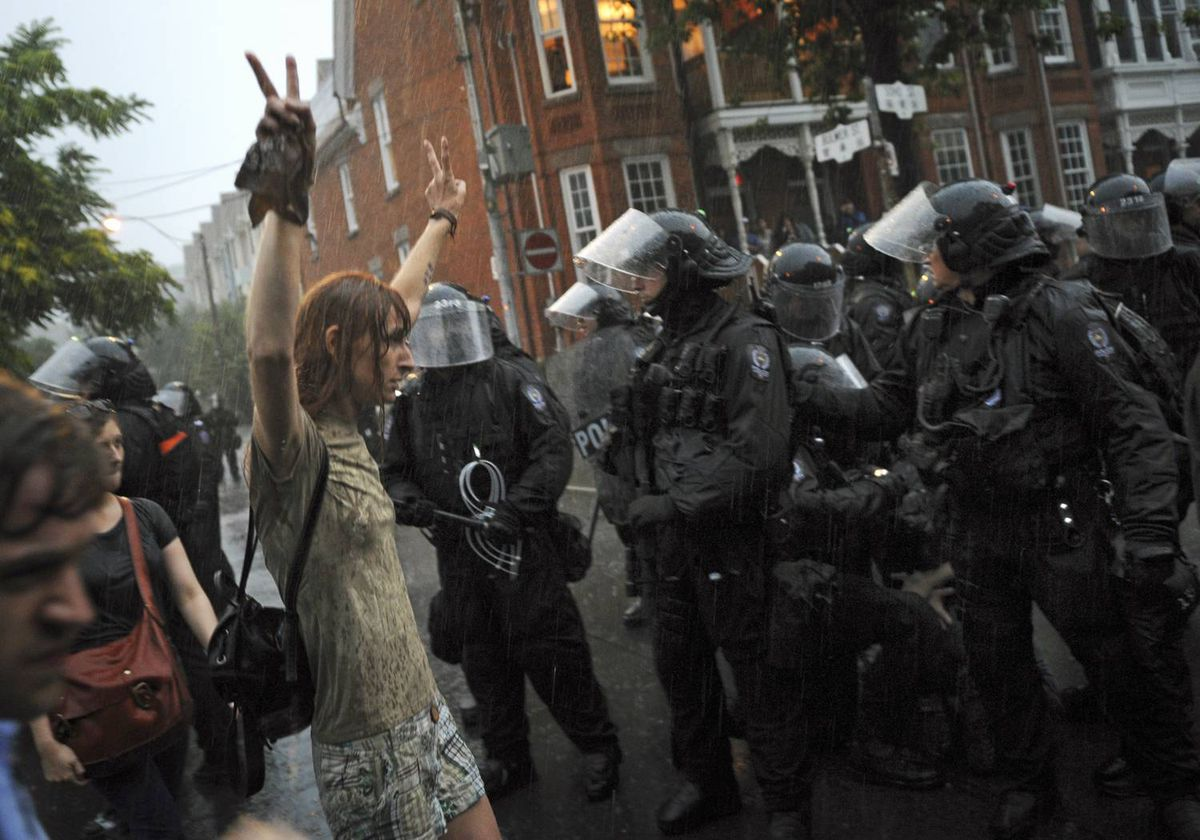 Protesters and police clash near Queen and Spadina during the G20 summit in Toronto on June 27, 2010.