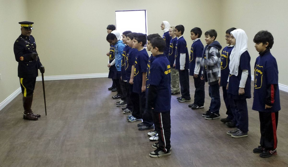 """Children at a Hamilton Islamic School take part in a RCMP """"junior police academy"""" in 2011. Police officials say they are having discussions about getting Mountie detectives and, possibly, Canadian Security Intelligence Service officers, into schools in Toronto so they can reach out to students."""