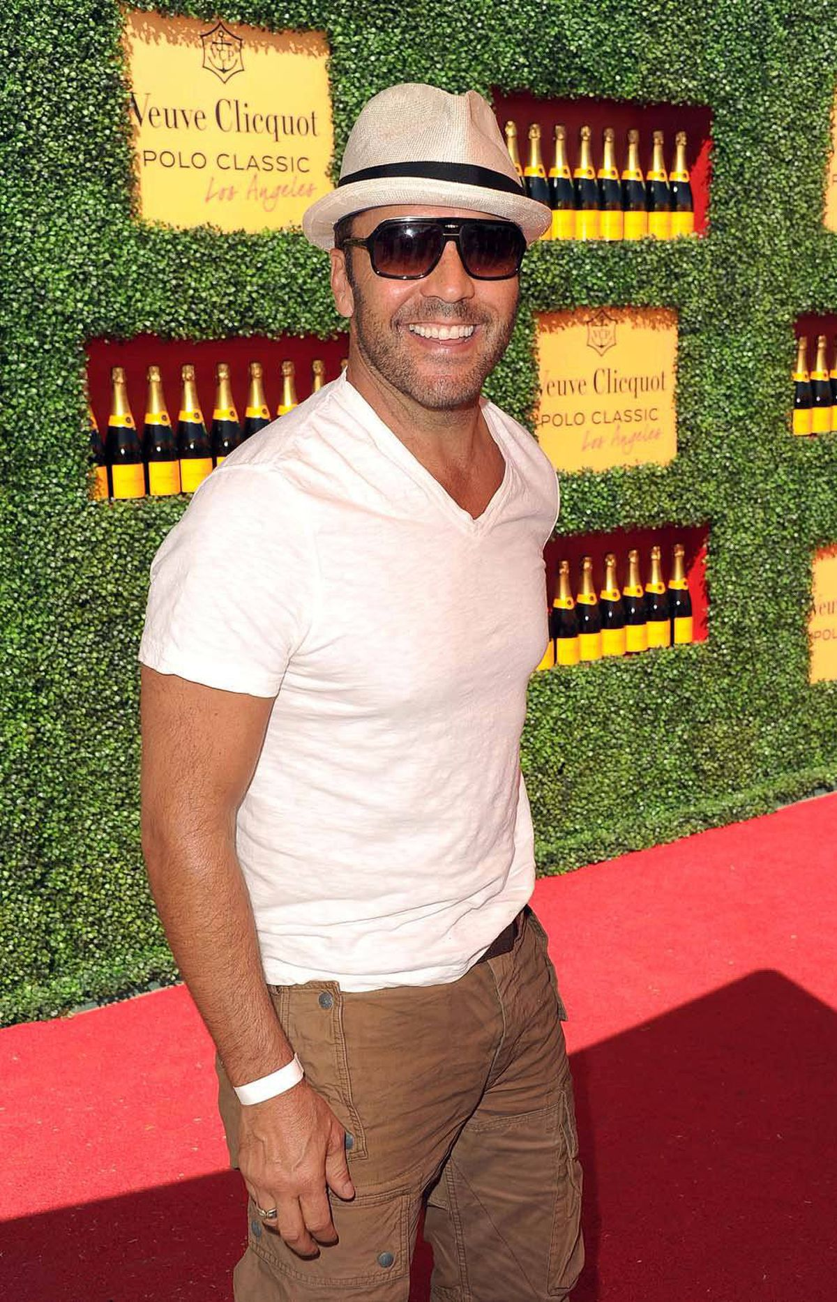 Actor Jeremy Piven strikes a blow for the disenfranchised at the Veuve Clicquot Polo Classic in Los Angeles on Sunday.
