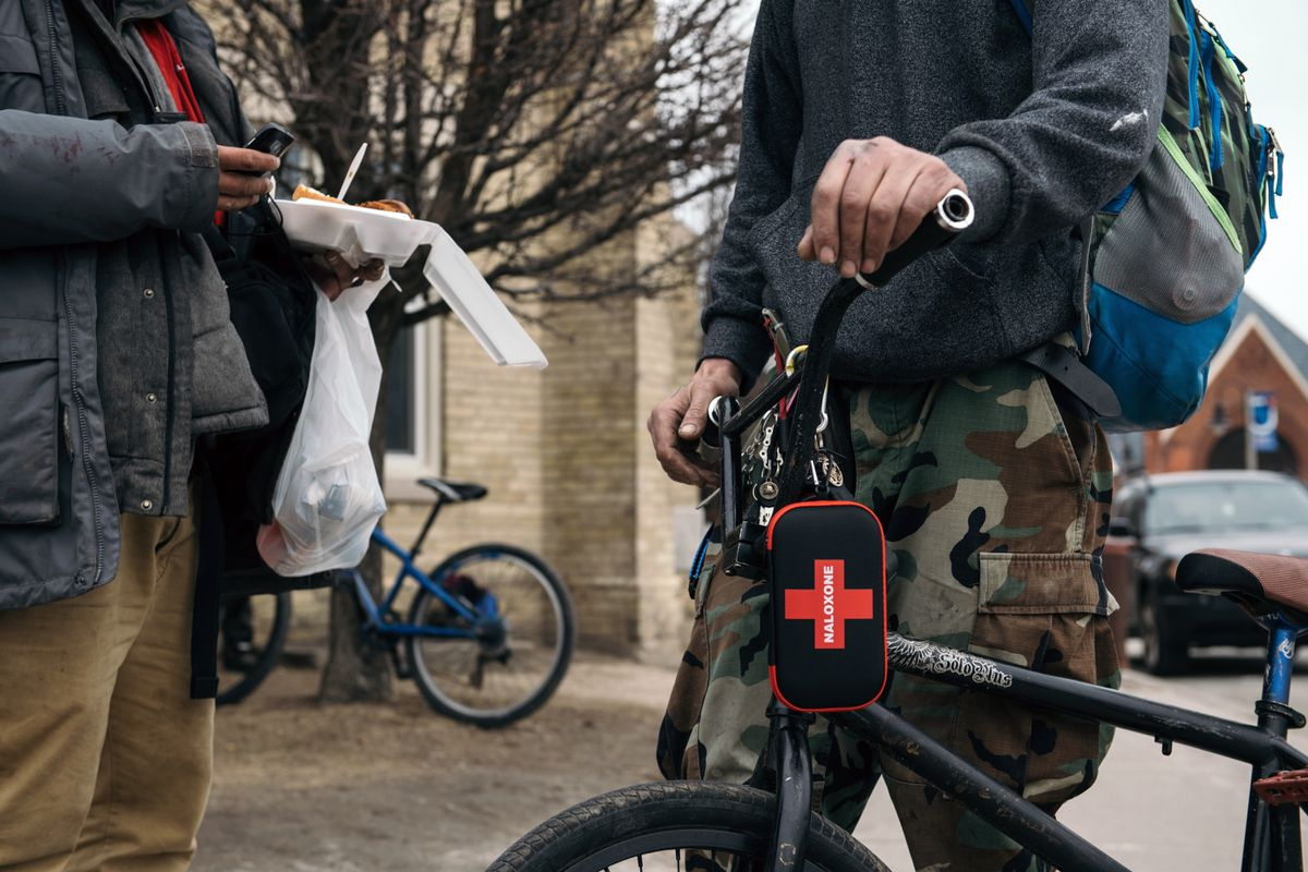 A man rides around downtown Oshawa, Ont., with a naloxone kit attached to his bicycle.