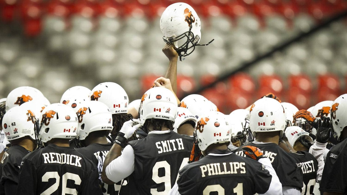 The B.C. Lions huddle-up for a cheer during practice at B.C. Place in Vancouver November 23, 2011.