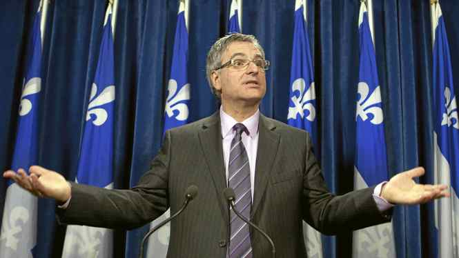 Quebec Justice Minister and Solicitor General Jean-Marc Fournier confirms the Quebec government will appeal a lower-court ruling that paves the way for common-law spouses to obtain alimony when they split from their partners on Dec. 15, 2010 at the legislature in Quebec City.