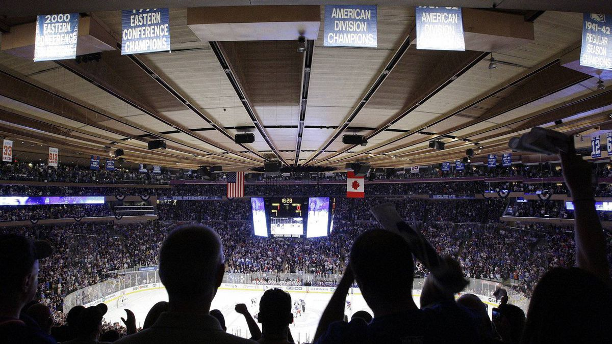 Fans cheer after New York Rangers' Brad Richards scored a goal during the first period of Game 7 of a second-round NHL hockey Stanley Cup playoff series against the Washington Capitals, Saturday, May 12, 2012, in New York. (AP Photo/Frank Franklin II)