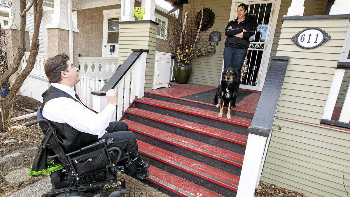 Alberta Liberal candidate Kent Hehr talks to voter Jan Pugh on the steps of her Calgary home.