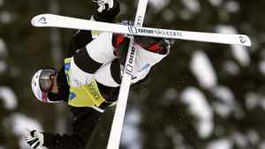 Mikael Kingsbury, of Canada, flips during the men's duel moguls qualifications at the World Cup Freestyle skiing competition Saturday, Feb. 4, 2012, at Deer Valley Resort in Park City, Utah. (AP Photo/Jim Urquhart)
