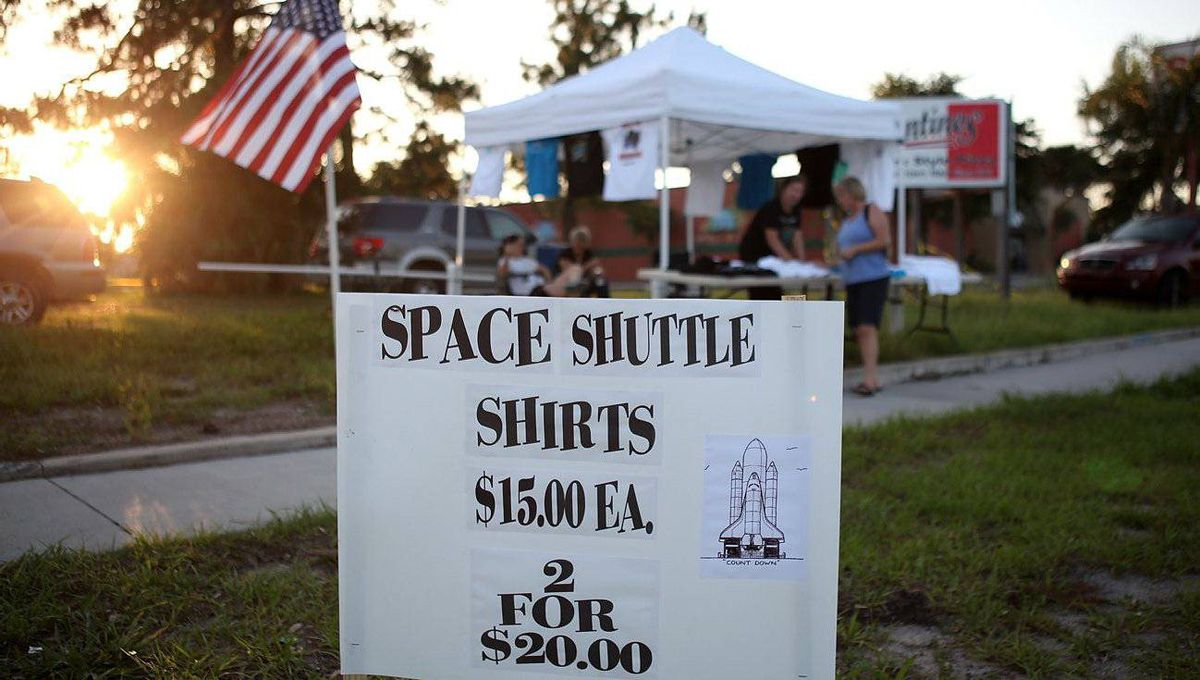 T-shirts with the space shuttle Endeavour are sold by a vendor ahead of Endeavour's final launc in Titusville, Florida.