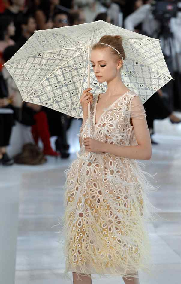 The collection was a reverie of prettiness, exuding romance, joy and a Parisan bel esprit. Working with feathered tweed, studded leather Broderie Anglaise (an intricate lace) and sportier tulle cashmere, designer Marc Jacobs pushed the limits of craft and timeless style, sometimes adding pastel-hued parasols for a touch of whimsy.