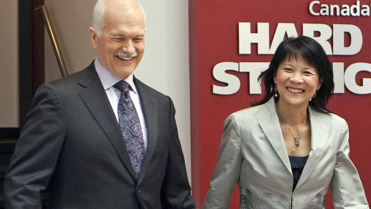 NDP Leader Jack Layton and his wife Olivia Chow walk out of Sun News Network studios after an interview on April 21, 2011 in Toronto.