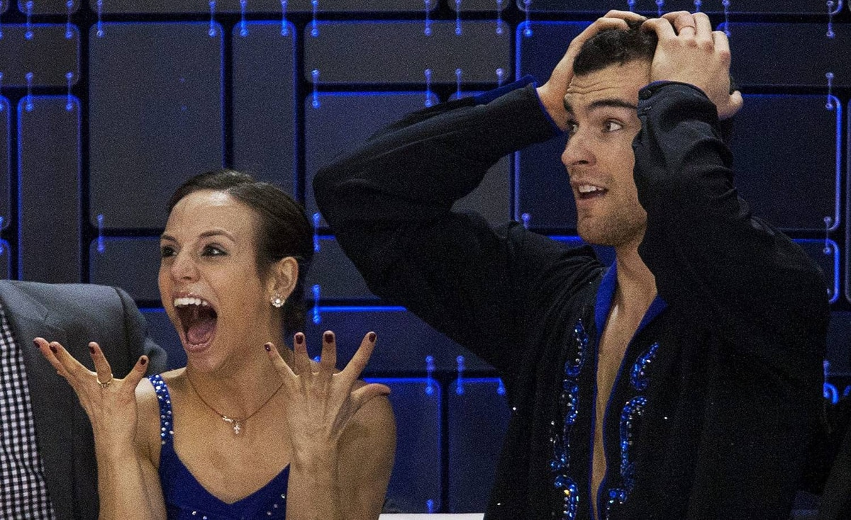 Meagan Duhamel and Eric Radford react as their score is posted after their skate to gold in the senior pair free competition at the Canadian figure skating championships in Moncton, N.B. on Saturday, Jan. 21, 2012.