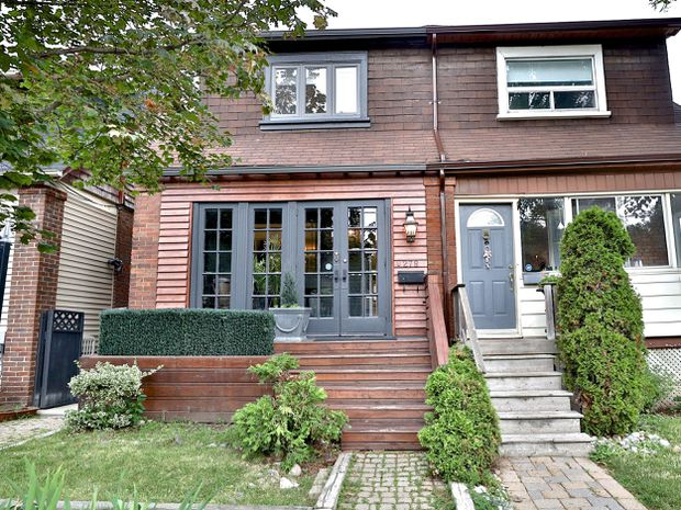 Major price cut nets 11 offers for semi-detached Toronto home