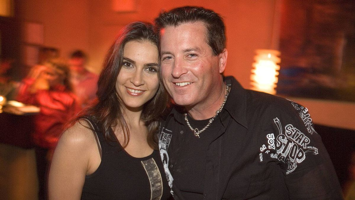 Nazanin Afshin-Jam poses with Bodog.net founder Calvin Ayre at a 2006 promotional event in Vancouver for one of his entertainment ventures. He's been involved in her music, film and human-rights projects.